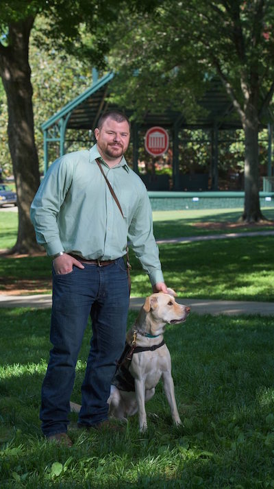UM graduate student Ben Stepp and service dog Arliegh have attended every class together since 2014. Photo by Robert Jordan/UM Communications
